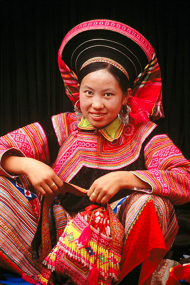 An ethnic flowery Hmong woman in Northern Vietnam, Cau Son, Lao Cai province, Vienam.