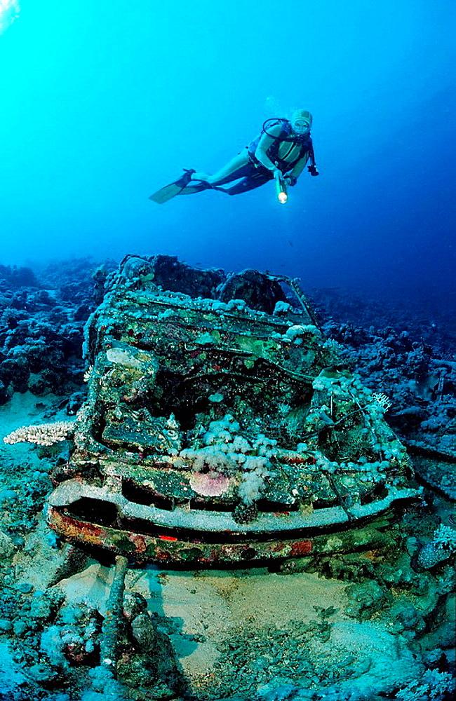 Scuba diver and Car wreck near Blue Belt shipwreck,  Sudan, Africa, Red Sea