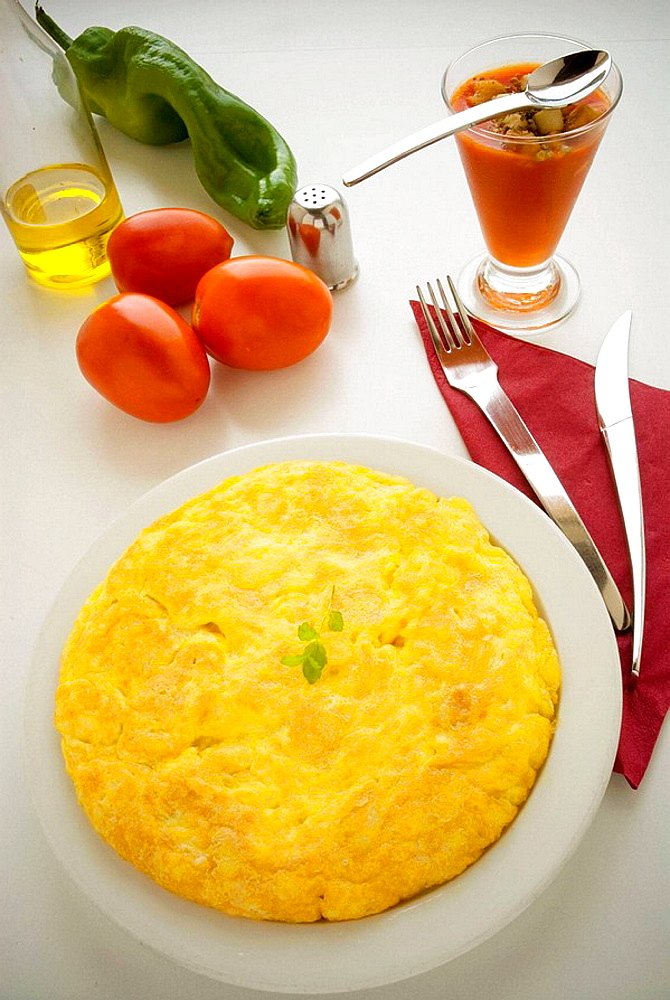 Potatoes omelet and gazpacho, typical Spanish food - 817-189230