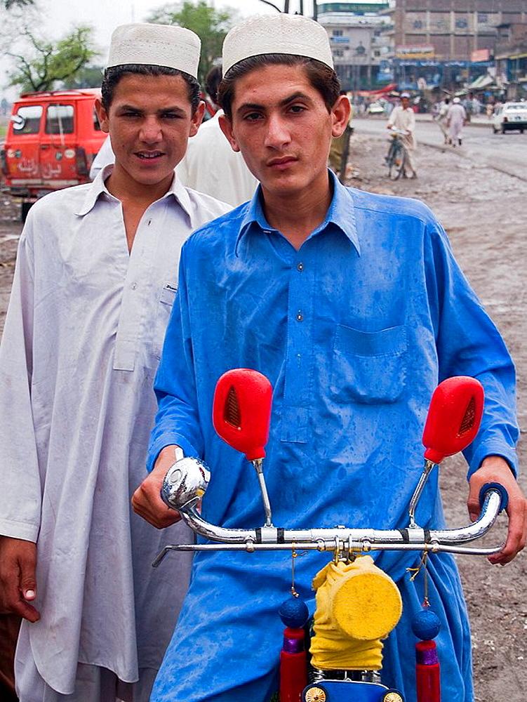 2 Afghan boys at refugee camp in Peshawar, Pakistan