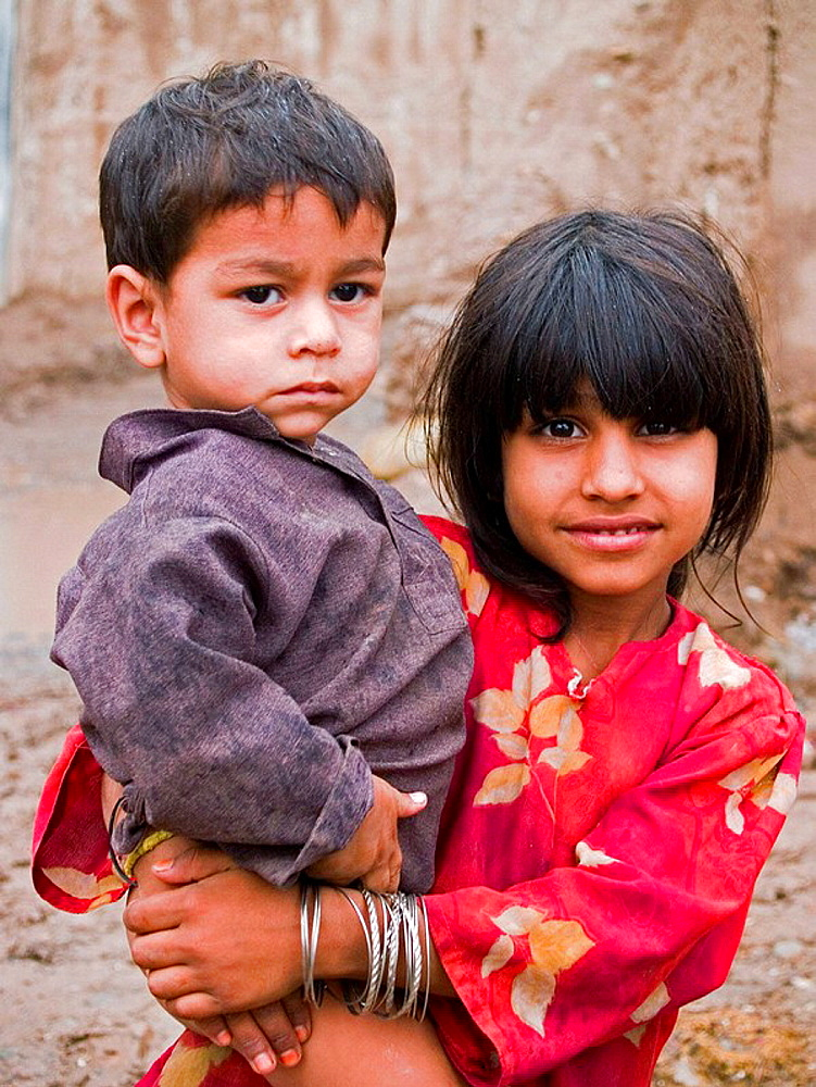 Sister and brother from an Afghan refugee camp, Peshawar, Pakistan