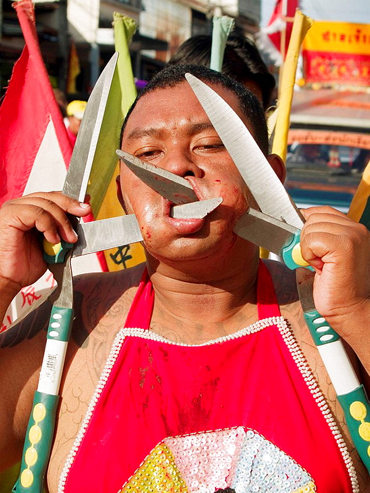 Garden shears in his face at the bizarre Vegetarian Festival, Phuket, Thailand - 817-189577