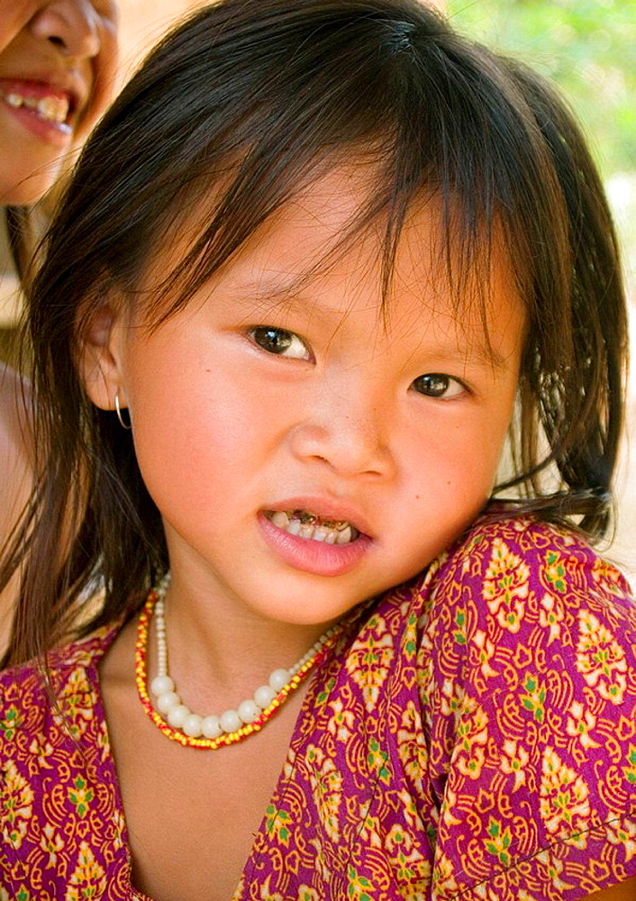 Lao girl with big smile in Muang Ngoi village in northern Laos