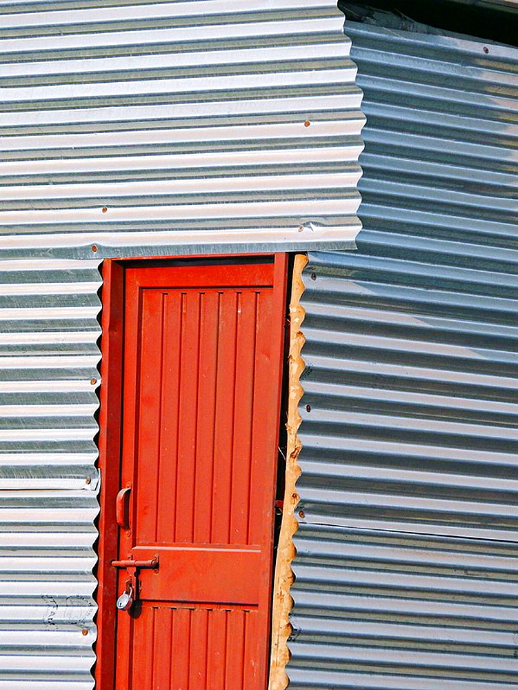 Temporary shed of a worker made of galvanized iron sheets at construction site  Pune, Maharashtra, India