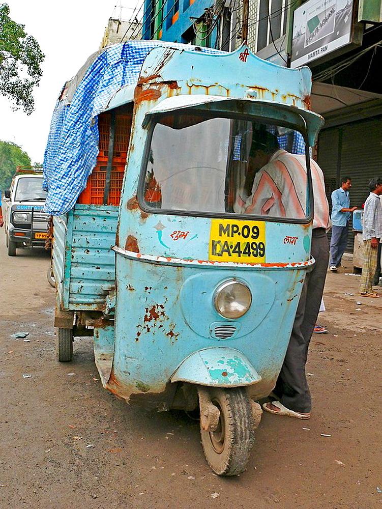 Three wheeled motorized taxi, known as an autorickshaw  Indore, Madhyaprsdesh, India