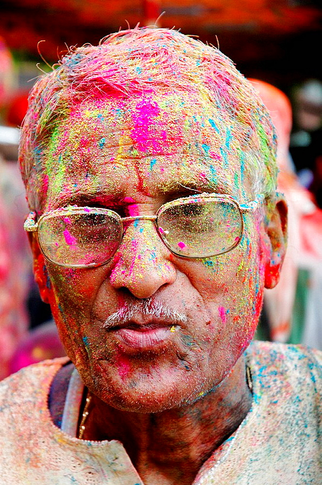 Panjim Goa, India, man with colored powder on the face during the Holi feast - 817-193978