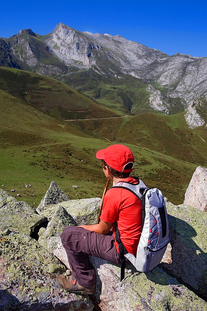 Mountain boy in the summit of Cueto Moro in the andara massif, Picos de Europa National Park, Bejes in the municipality of Cillorigo de Liebana, in Cantabria, Spain