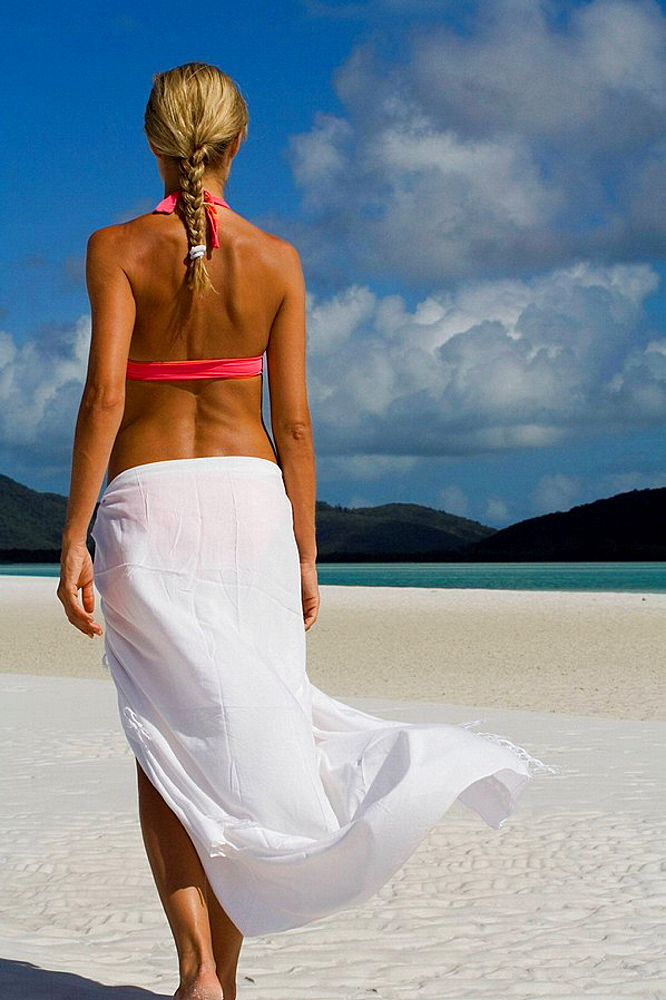 Woman in white sarong on Whitehaven Beach, Australia