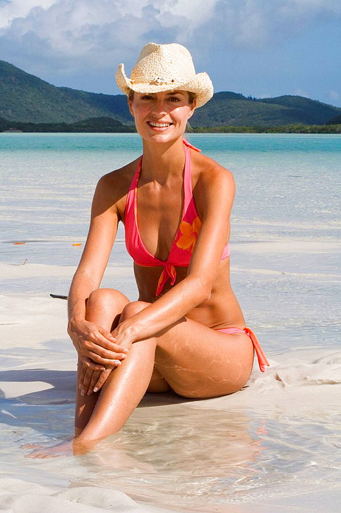 Portrait of woman in bikini and cowboy hat, Whitehaven Beach, Australia