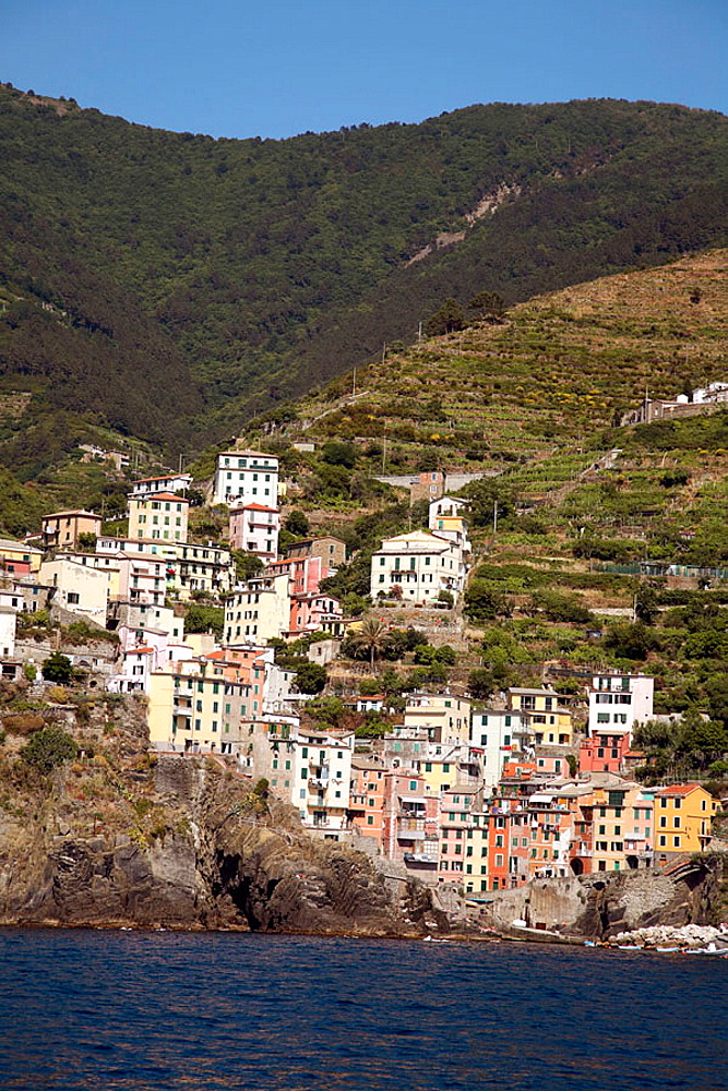 The colourful village of Riomaggiore clings to a mountainside overlooking the Ligurian Sea,  The village is one of five that make the Cinque Terre, The region is now a Unesco World Heritage site, 2006, Riomaggiore, Liguria, Italy