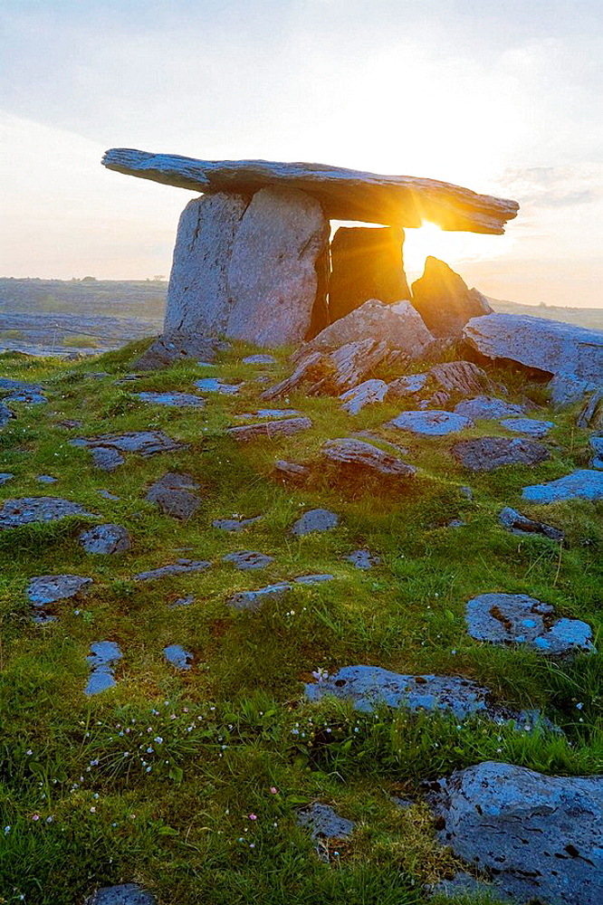 Poulnabrone Megalithic Tomb with rising sun in the Burren, Ireland, Europe