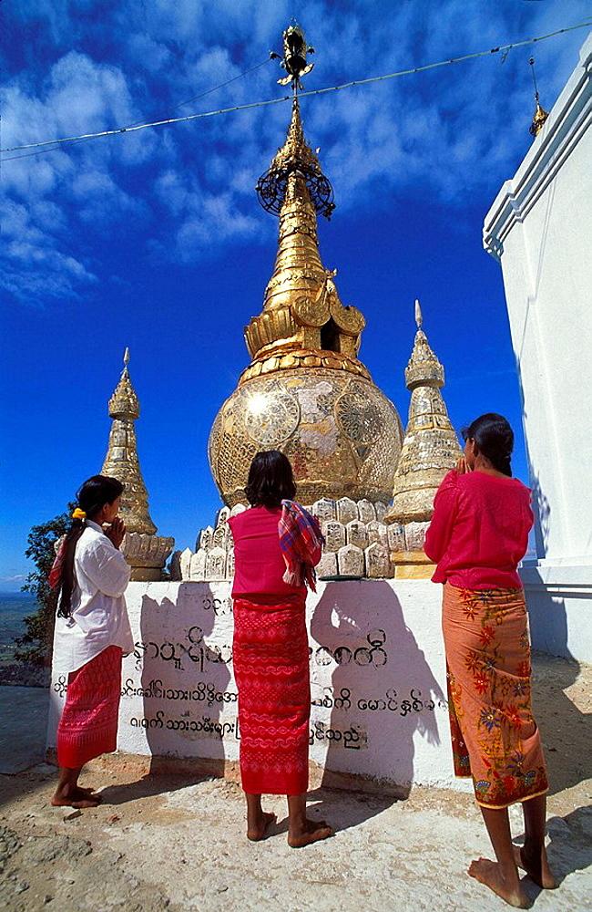 Women in prayer, mount popa, Myanmar