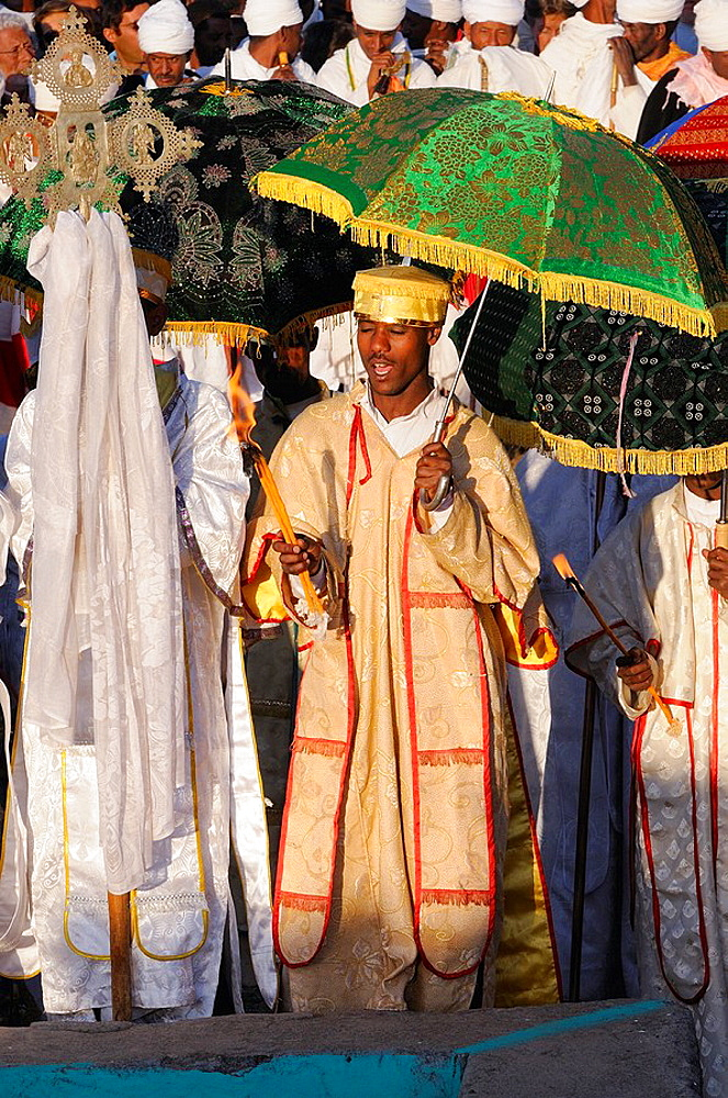 Ethiopia, Lalibela,Timkat festival, Orthodox priests in prayer before the cross shaped pool where the baptism will take place   Every year on january 19, Timkat marks the Ethiopian Orthodox celebration of the Epiphany  The festival reenacts the bapti