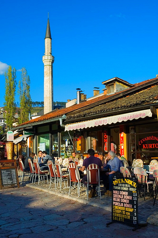 Fast food restaurants along Pigeon Square the main square in Bascarsija district in Sarajevo Bosnia Herzegovina Europe
