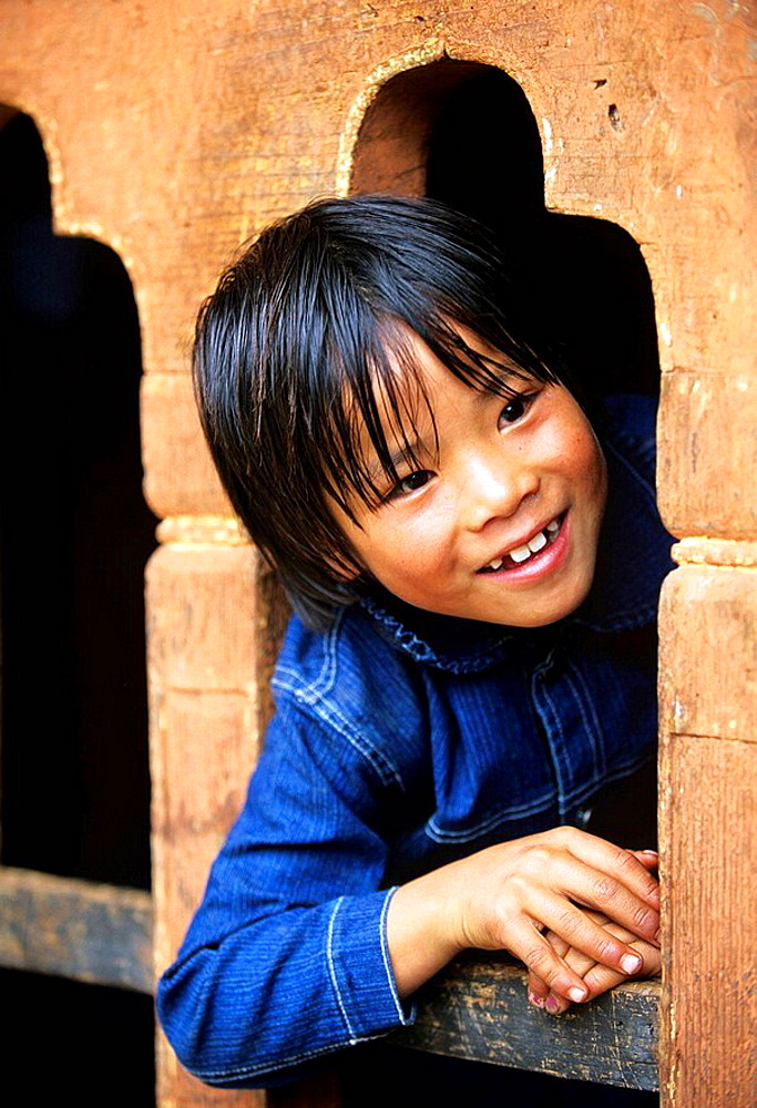 Portrait of a young joyful girl in Jakar, Bumthang, Bhutan