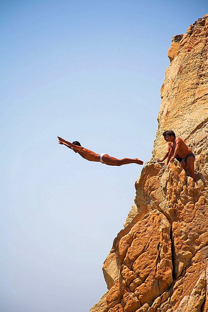 Cliff diver, a clavadista, diving off the cliffs at La Quebrada, Acapulco, Guerrero State, Mexico