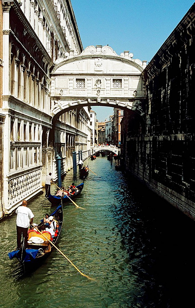 Bridge of Sighs and tourists sightseeing in a gondola on the Rio Del Palazzo, Venice, Italy