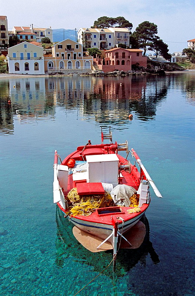 Old red and white fishing boat moored in harbour, Assos, Kefalonia, Greece
