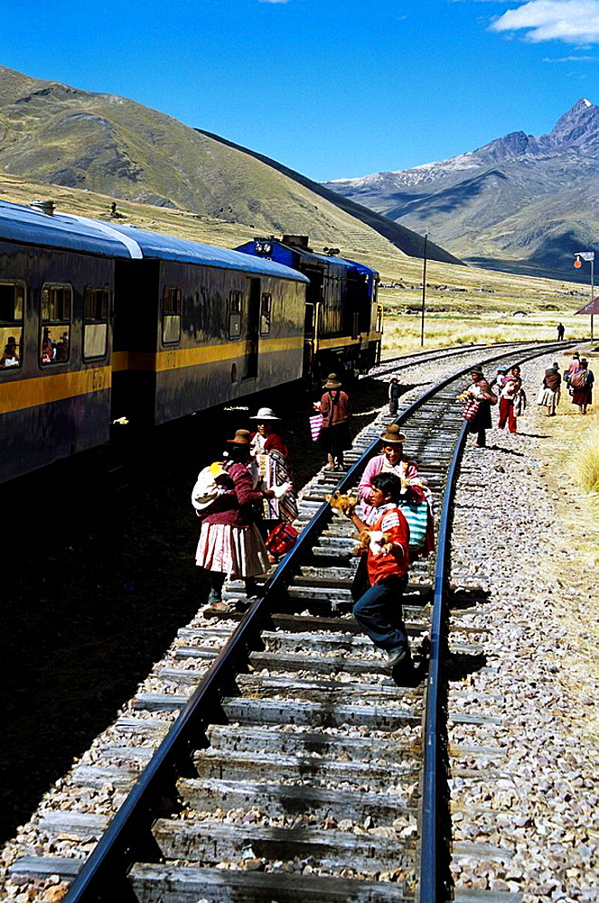 Women selling gifts on railway track, near La Raya, Puno to Cusco Perurail train journey, Peru