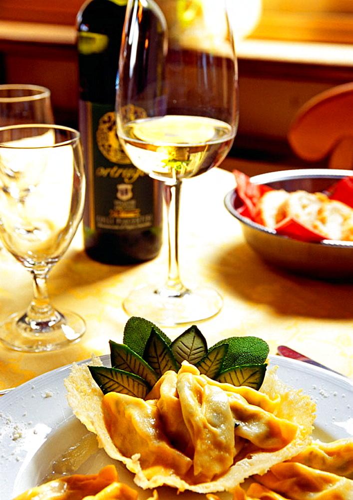'La Rocca da Paolo' restaurant, Tortellini di Ricotta e Spinaci al Burro Fuso e Salvia con Cialda di Formaggio Grana and Ortrugo wine, Castell'Arquato, Emilia Romagna, Val d'Arda, Italy.