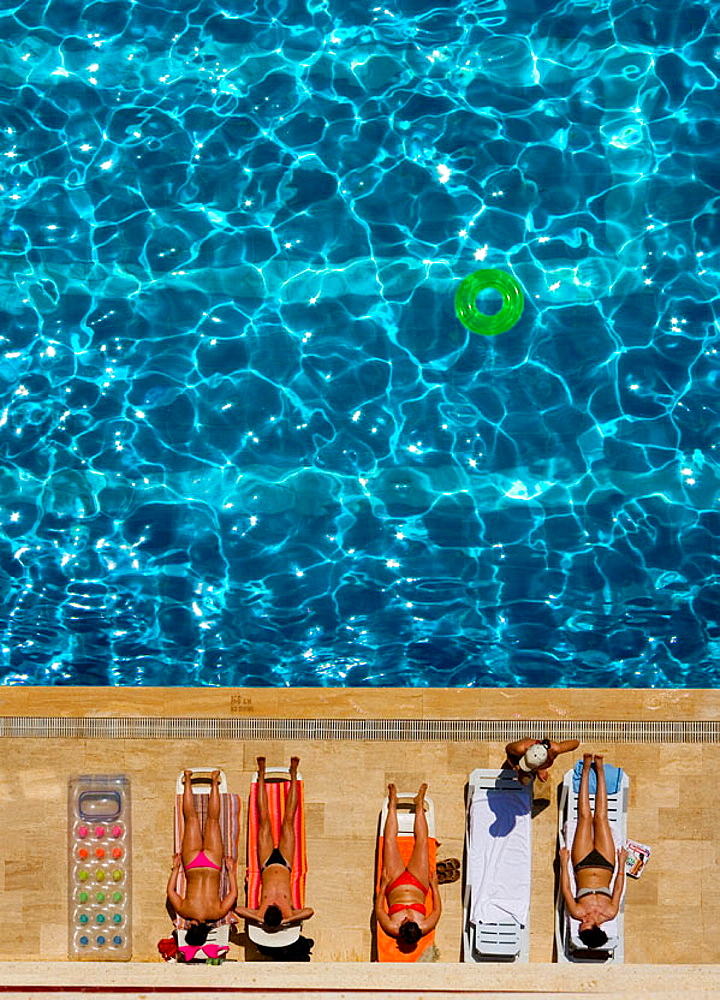 Tourists sunbathing by a pool, Turkey - 817-234921