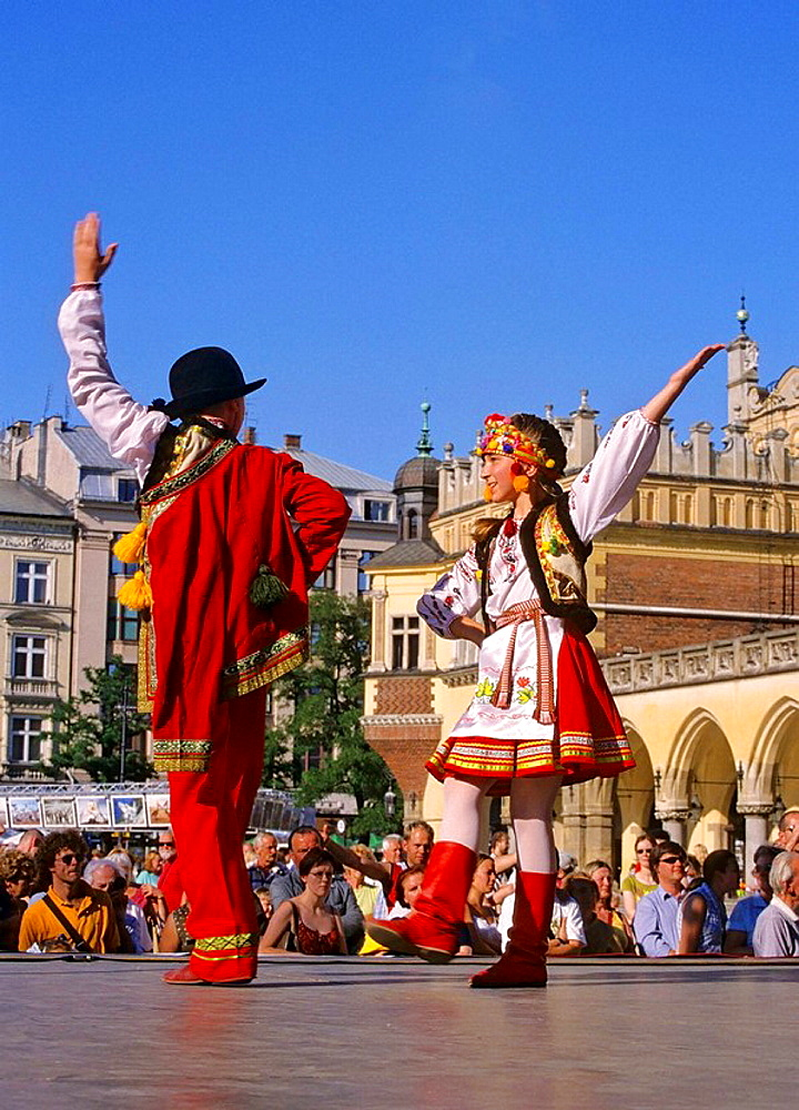 Poland, Krakow, Folk dance festival at Main Market Square - 817-235482