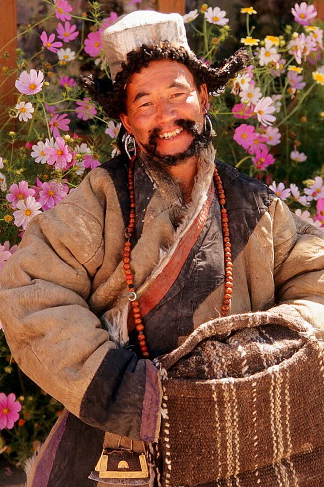 Leh, man in traditional dress, Ladakh, Jammu and Kashmir, India.