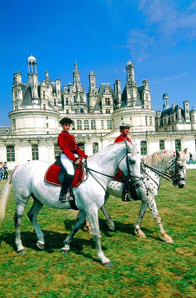 Horsemen in front of Chambord Castle, Val-de-Loire, France