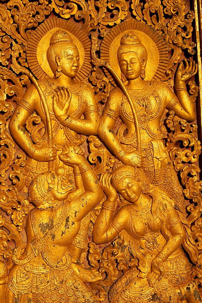 Laos, Luang Prabang province, city of Luang Prabang, World heritage of UNESCO since 1995, Wat Xieng Thong, door detail