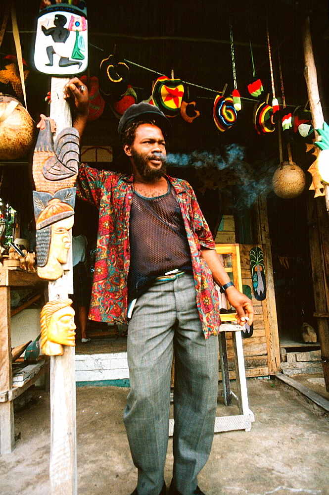 Jamaican man smoking a joint in front of a shop in Negril, Jamaica