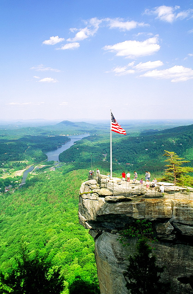 Union US flag on Chimney Rock overlook viewpoint landmark in Chimney Rock Park above Lake Lure North Carolina USA