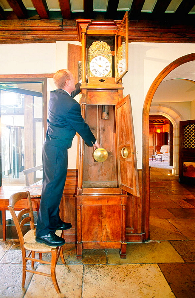 The maitre d'hotel checks the clock after Bernard Loiseau died, Famous hotel and restaurant 'La Cote d'Or', three stars in the Michelin Red Guide, Saulieu, Cote d'Or, Burgundy, France.