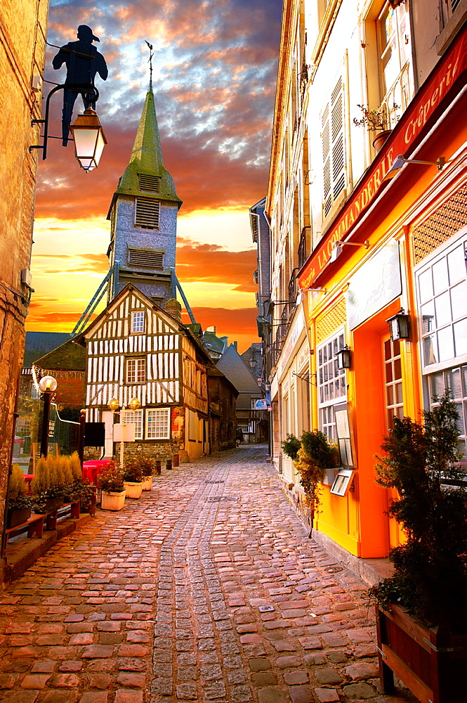 street at sunset with church and half timbered building Honfleur, Normandy, France