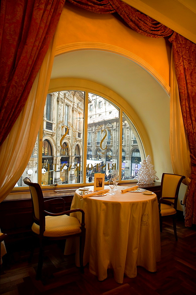 Savini Restaurant A dining room corner with window and view to the Vittorio Emanuele Gallery Milan, Lombardy, Italy, Europe