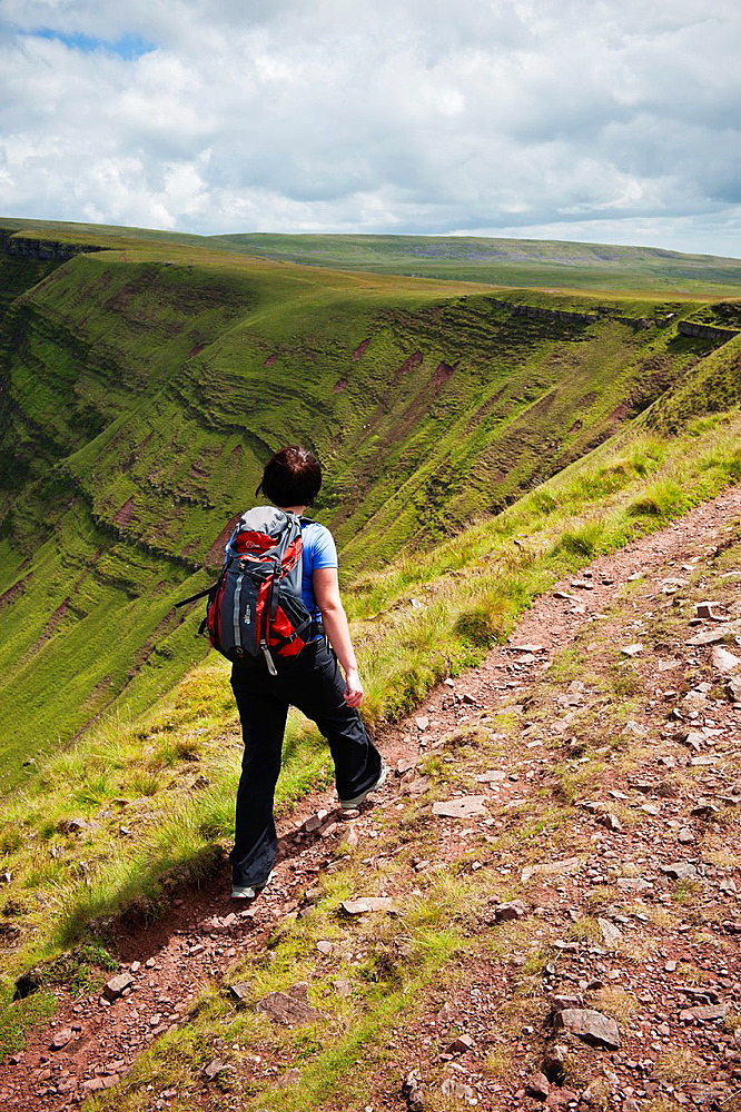 Female hiker on Bannu Sir Gaer ridge, Black Mountain, Brecon Beacons national park, Wales