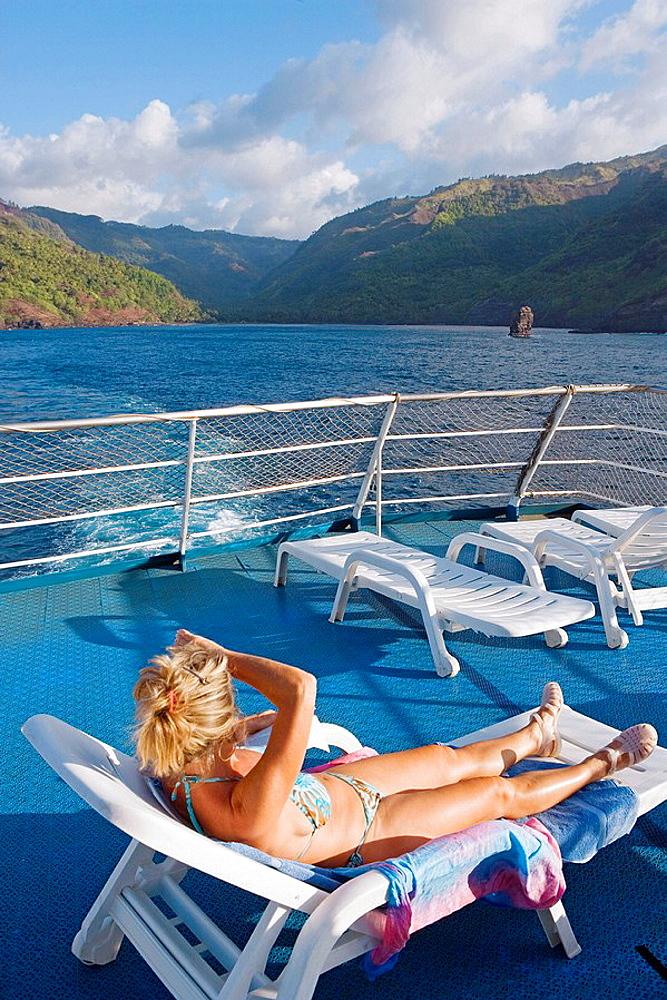 Stopover in Hiva Oa island, Hanaiapa bay view from the ship, Marquesas archipelago, French Polynesia