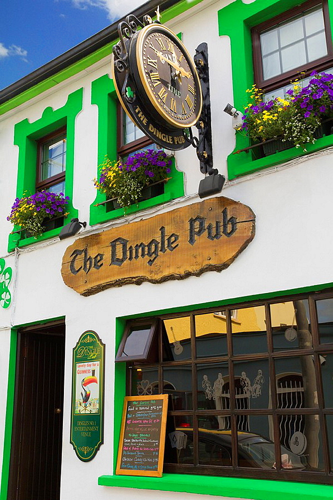 Ireland, Europe, white, green, painted, pub, with, Guinness, toucan, sign, large, clock, hanging, outside, Dingle, pen. Ireland, Europe, white, green, painted, pub, with, Guinness, toucan, sign, large, clock, hanging, outside, Dingle, pen