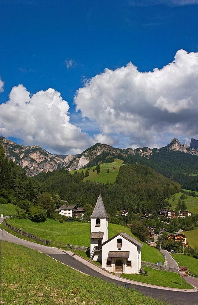 Italy, Europe, St. Cyprian, town, Tiers, South Tyrol, South Tirol, Alto Adige, church, Rosengarten, clouds, Dolomites, . Italy, Europe, St. Cyprian, town, Tiers, South Tyrol, South Tirol, Alto Adige, church, Rosengarten, clouds, Dolomites,