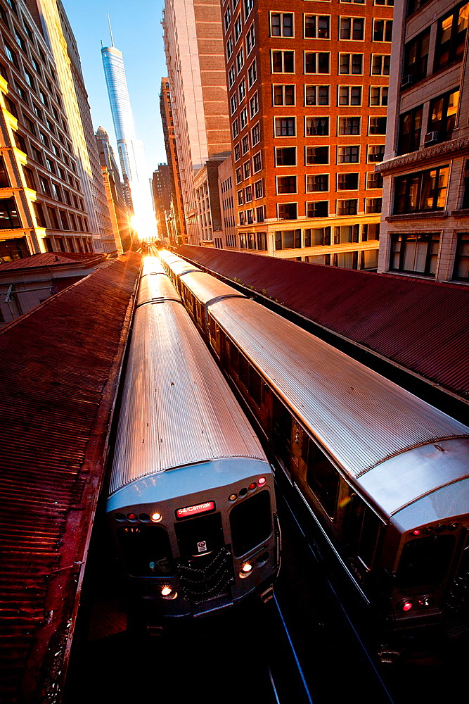 Sunrise illuminates a train in the Chicago rapid transit system known as theL in Chicago, IL, USA