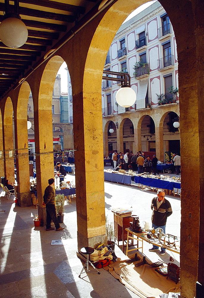 Flea market in Sant Pere Square. Reus, Tarragona province, Catalonia, Spain.