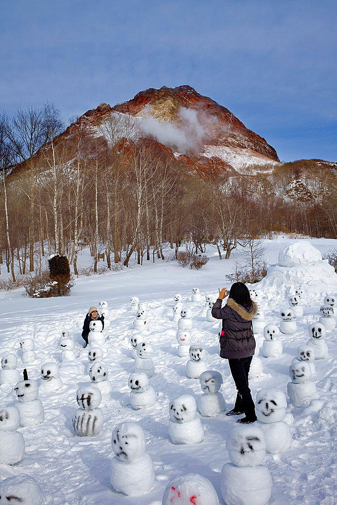 Tourist, in background Showa Shinzan, near lake Toya, Shikotsu-Toya National Park, Hokkaido, Japan