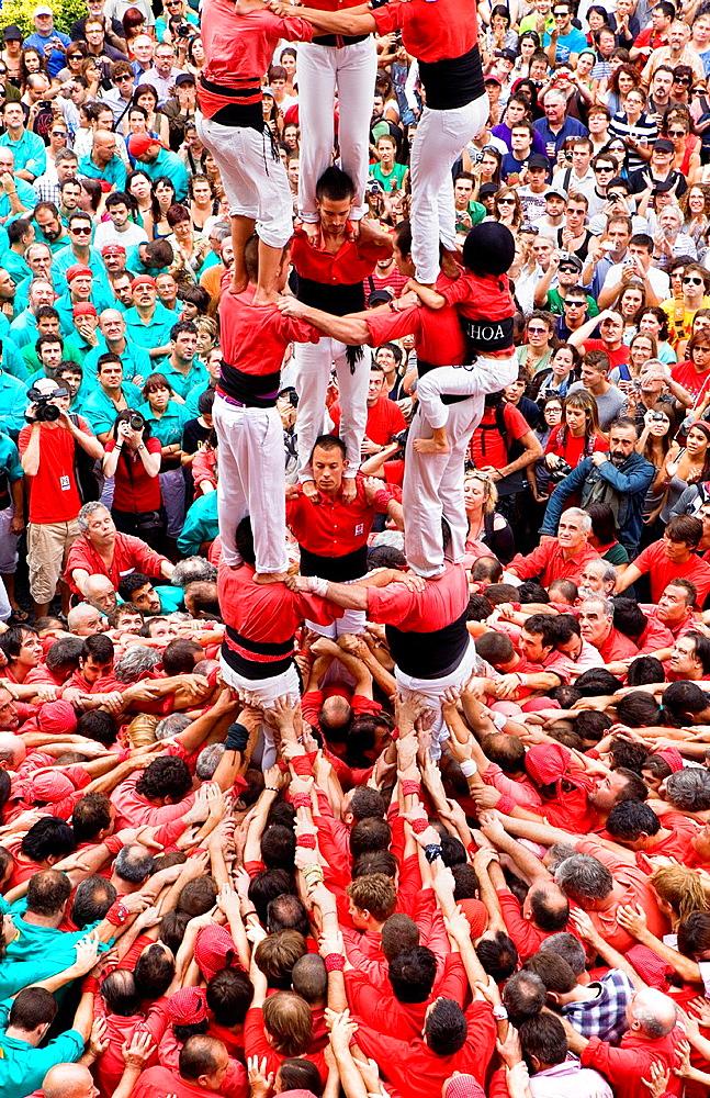 Castellers de Barcelona 'Castellers' building human tower, a Catalan tradition Festa de la Merce, city festival Placa de Sant Jaume Barcelona, Spain