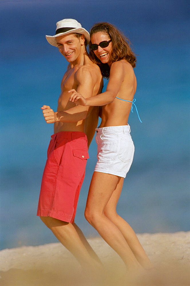 Dancing couple at the beach
