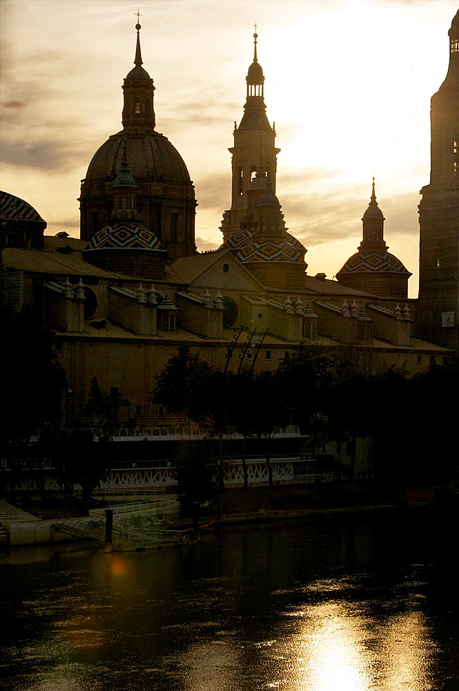 El Pilar Basilica, and its reflections in Ebro river, skyline, at night, Zaragossa, Aragon, Spain