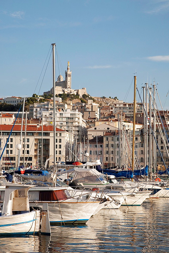 Boats in the Harbour of the Vieux Port with the Baslique Notre Dame de la Garde Church in the background, Marseilles, France
