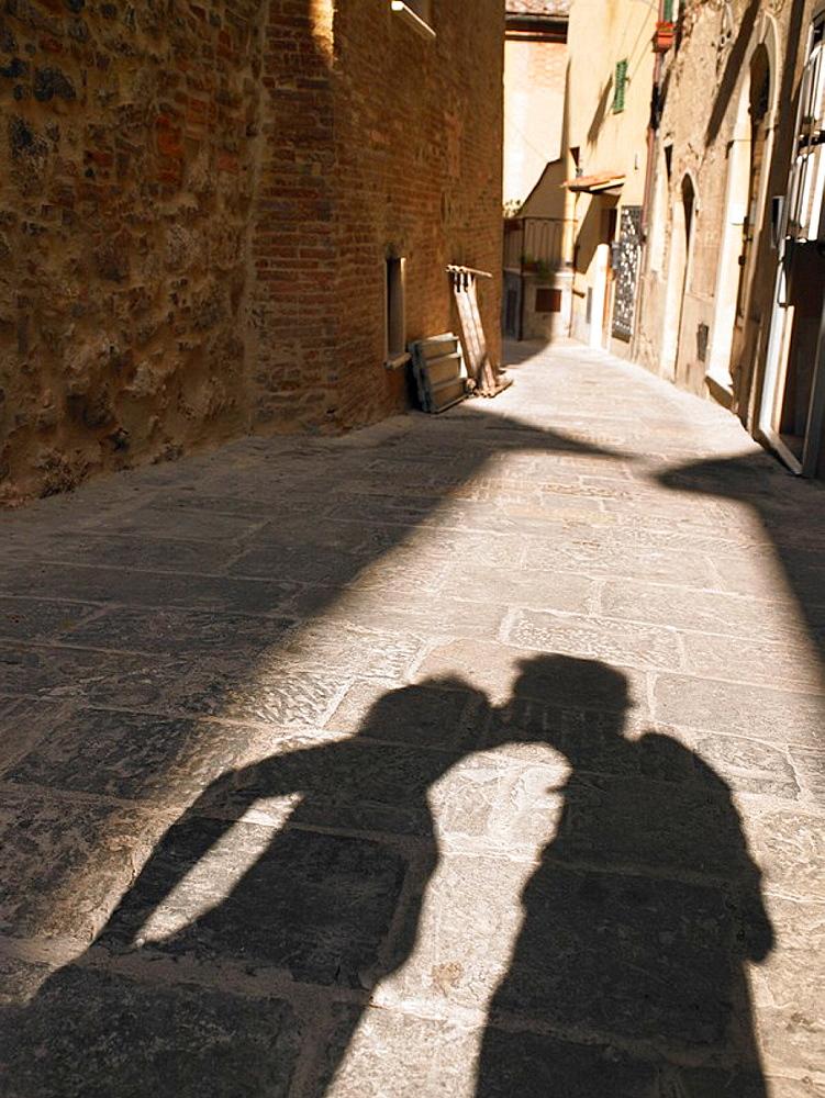 Shadows of people in village street