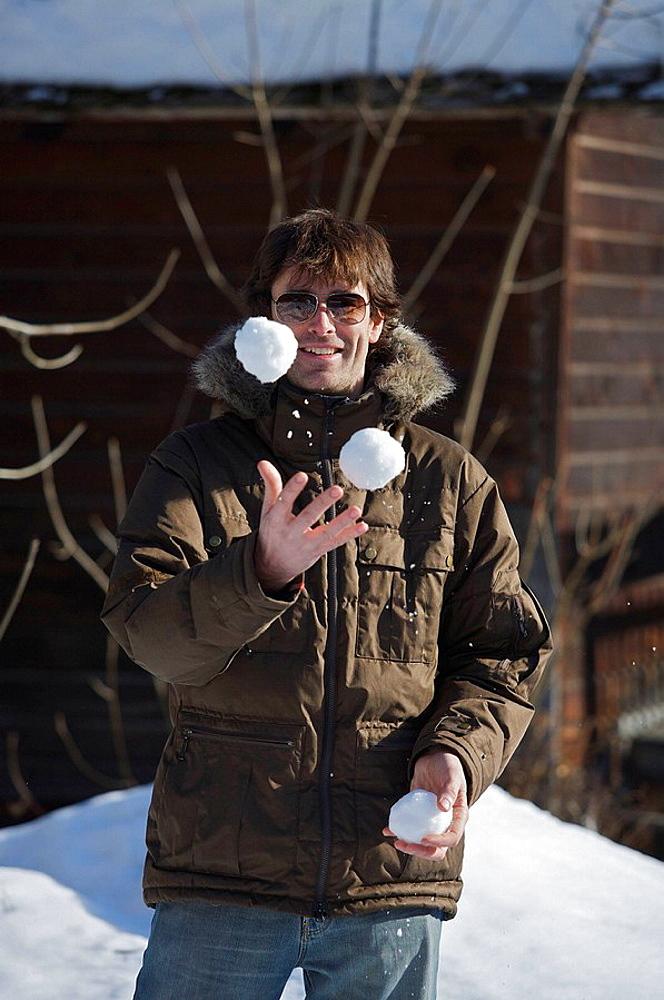 Male in casual ski wear, Male in casual ski wear, juggling snowballs
