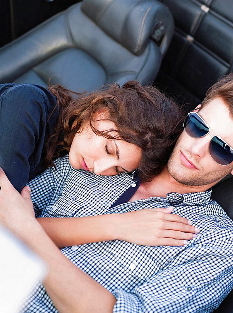 couple lying in open topped car