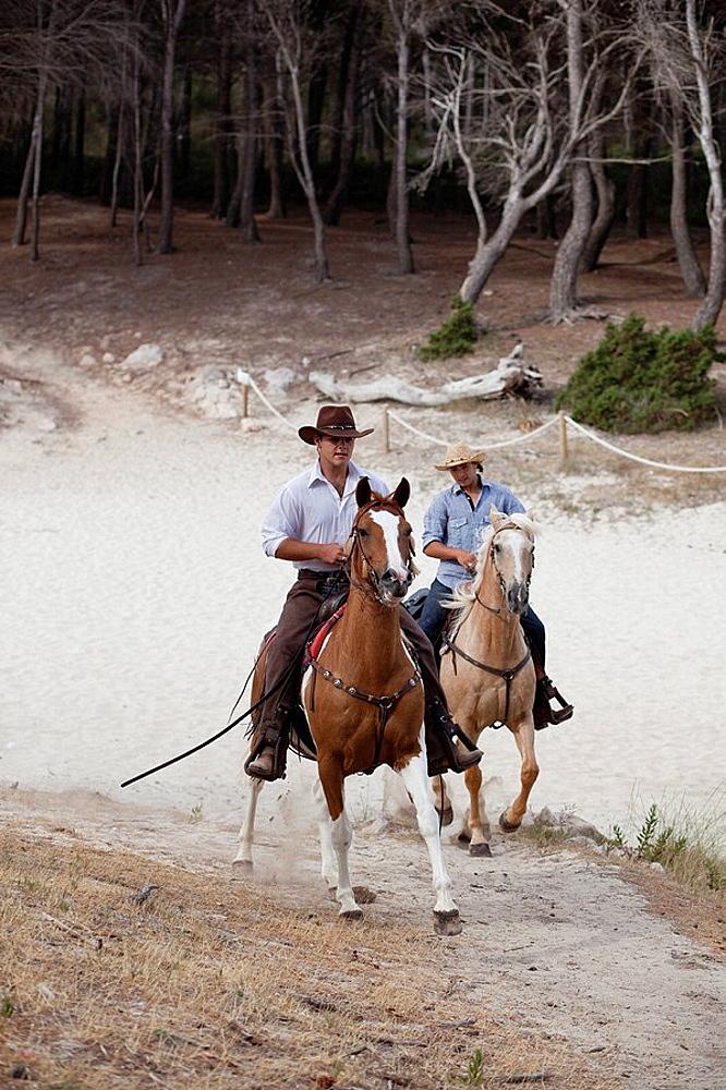 men riding horses
