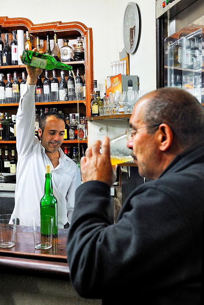 Spain, Asturias, Aviles, Cider bar 'Casa Lin', Escanciador pouring cider the traditional way